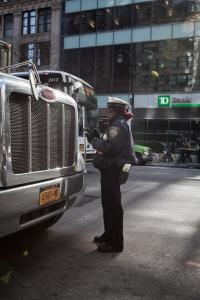 New York 2015 -policewoman and a truck © Marco Salvadori